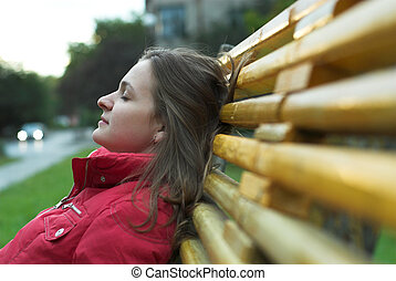 Depressed woman - Depressed young woman is sitting on the...
