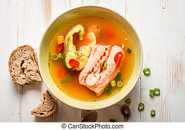 Salmon soup served with bread