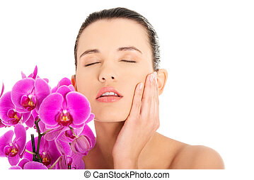 Young woman with health skin and orchid