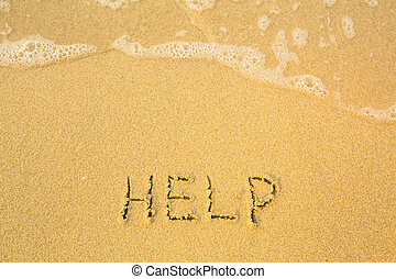 Help, written in sand on beach texture - soft wave of the sea.