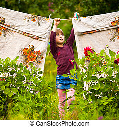 Little five-year girl with clothespin outdoor