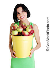 Smiling woman with apples