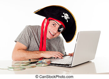 man in pirate hat downloading music on a laptop - man...