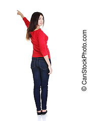 Happy young woman pointing on copy space - Happy , excited...