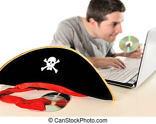 Young man in pirate costume and Computer - Young with...