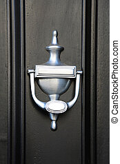 Knocker - Modern silver knocker at black door
