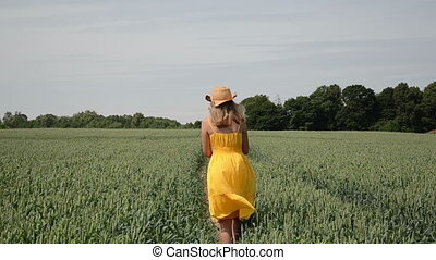 rye beaten path girl - young farmer with a yellow dress and...
