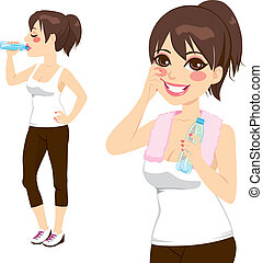 Drinking Bottle Water - Beautiful brunette holding a bottle...