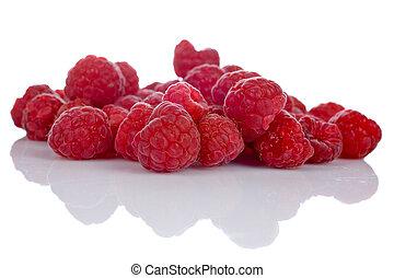 Raspberries - A raspberries pile reflected on white...