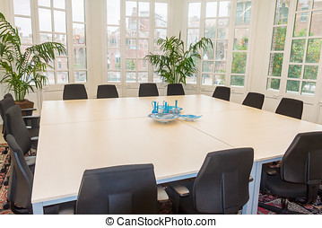 table and chairs in meeting room