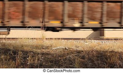 train - low angle view of railroad boxcars passing by on the...