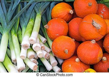 Leek and pumpkin at a market - Fresh leek and pumpkin seen...