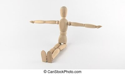 Wooden man doing exercises