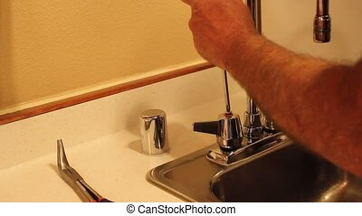 faucet repair - repairing the faucet handle on a kitchen...