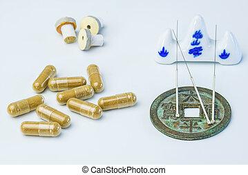 Acupuncture needles, moxa cones, herbal pills
