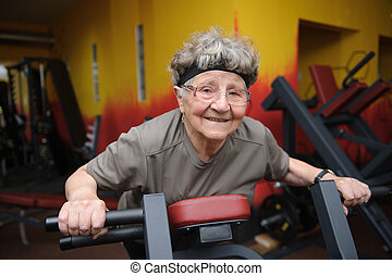 Active senior woman exercising at the gym