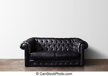 sofa - black leather sofa in room