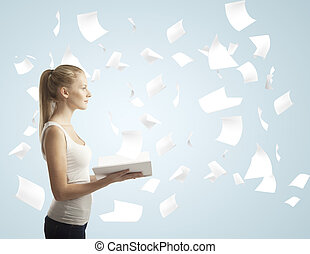 girl holding book with flying around paper