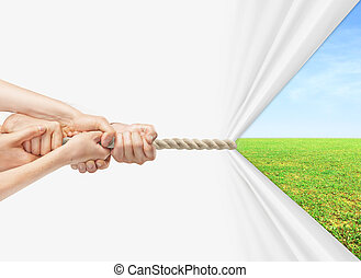 hands pulling rope to field