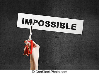 impossible - hand scissor plate with impossible on a gray...