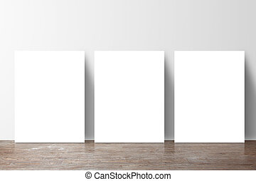 three placard standing next to a gray wall
