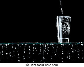 Pouring water - Overflowing glass of water