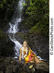 girl in a tropical waterfall - young woman in a tropical...