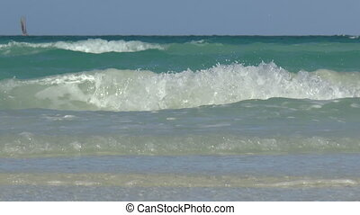 Caribbean Sea. - Waves touching the shoreline in the...