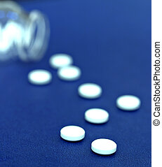 Medicine Pills - Medicine pills spread on a blue background...