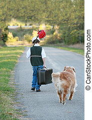 Boy Traveling with Dog - A Young Boy Traveling Away From...