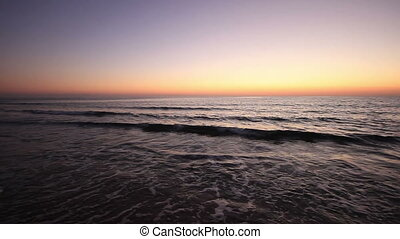 Sea dusk - Sea waves on a beach at the dusk, after a scenic...