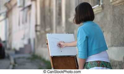 Young girl artist drawing