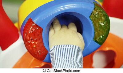 Childrens toy - Part of infant toys Boy puts his hand inside...