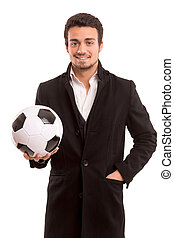 Coach - Studio picture of a handsome young football coach
