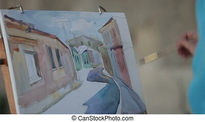 Girl artist painting in watercolor city street - Girl artist...