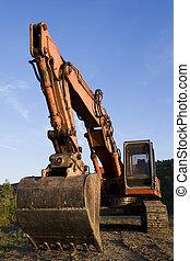Excavator - A big orange excavator at construction site