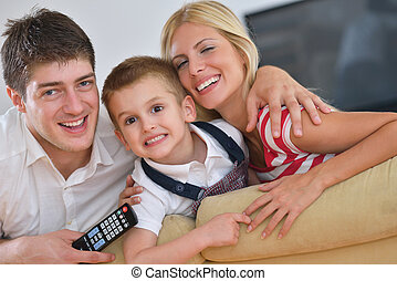 family at home - happy young family with kids in bright...