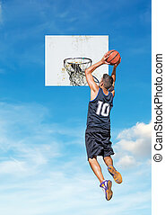 basketball and sky - basketball player dunking with a sky in...