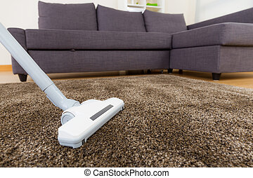 Carpet with vacuum cleaner in living room