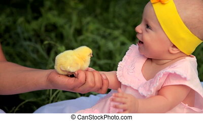 Baby with chickens in the garden