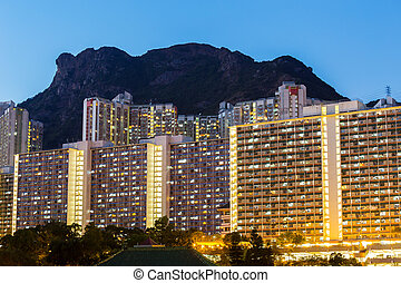 Kowloon with lion rock at night