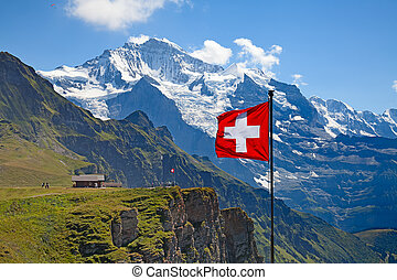 Swiss flag on the top of Mannlichen Jungfrau region, Bern,...
