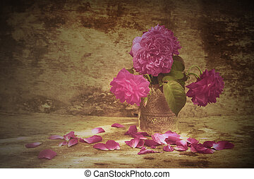 Still life with pink roses flower in silver vase on grunge...