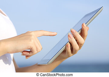 Profile of a woman hands holding and browsing a digital...