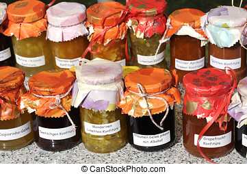 Jam jars - Jam in small jars with wrapping paper and ribbon.