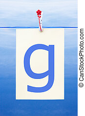 Seamless washing line with paper showing the letter g -...