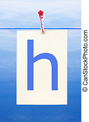 Seamless washing line with paper showing the letter h -...