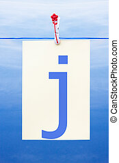 Seamless washing line with paper showing the letter j -...