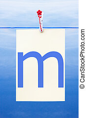 Seamless washing line with paper showing the letter m -...