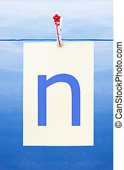 Seamless washing line with paper showing the letter n -...
